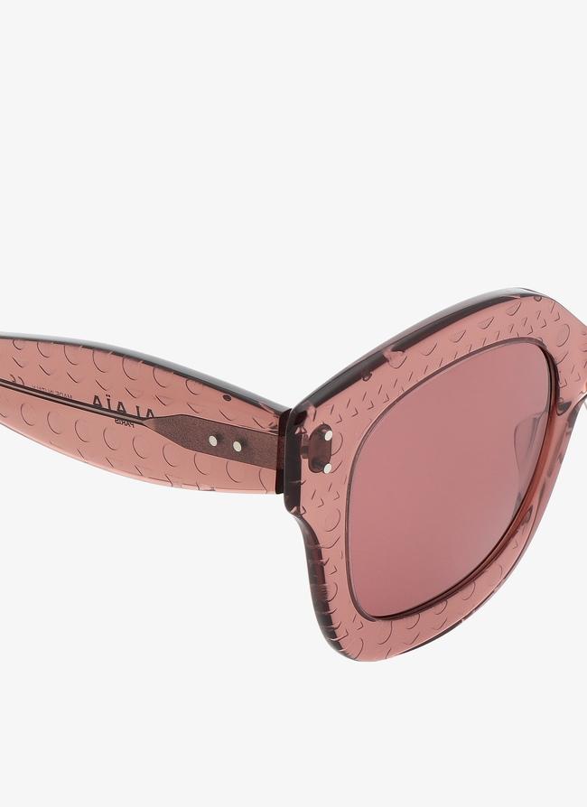 Lunettes de soleil rose blush - maison-alaia.com